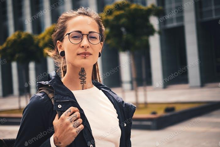 Portrait of tattooet pretty girl in glasses