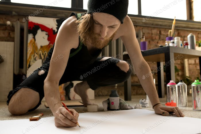Contemporary Artist Sketching on Floor