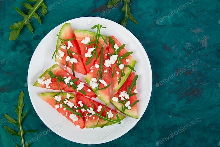 Fresh summer watermelon salad with feta cheese and arugula