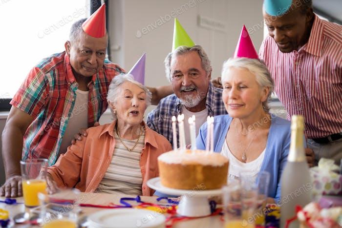 Happy senior people celebrating birthday