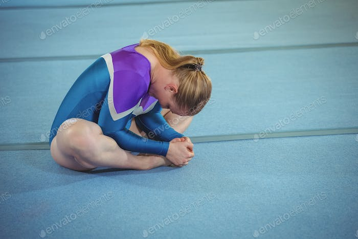 Female gymnast performing stretching exercise