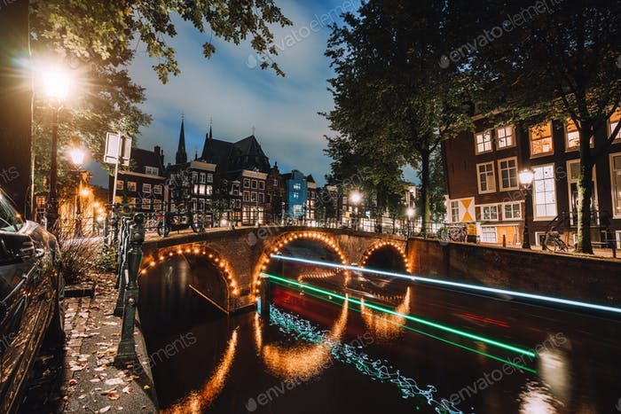 Light trails at famous canals in Amsterdam at dusk. Long exposure shot