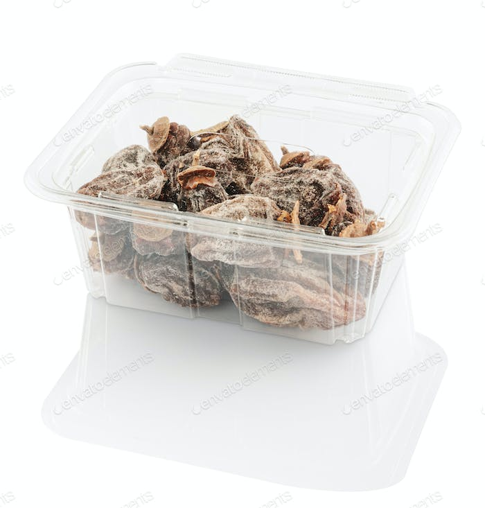 dried persimmon in a plastic food container, isolated on a white background with clipping path