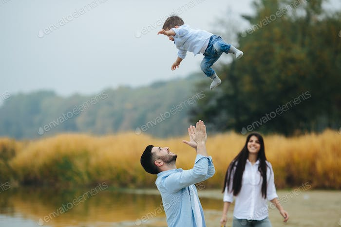 Dad throws up his young son