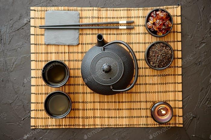 Asian green tea set on bamboo mat