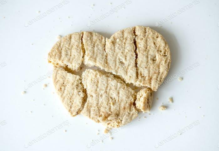 Closeup of a broken heart shaped cookie