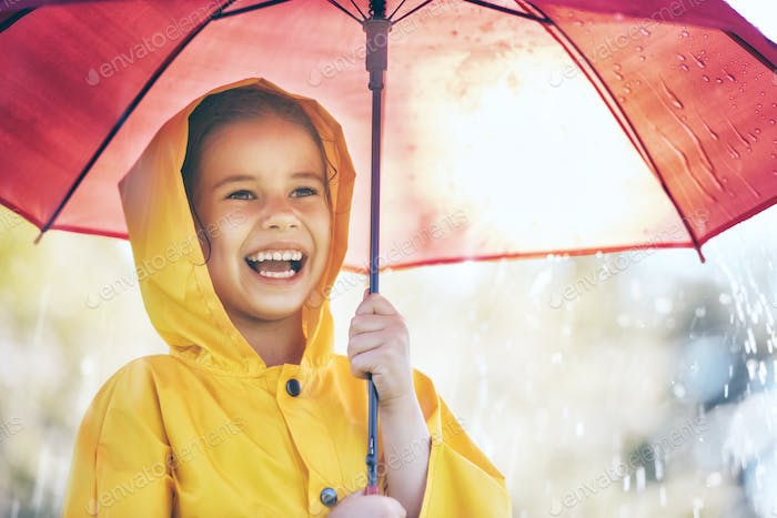 child with red umbrella