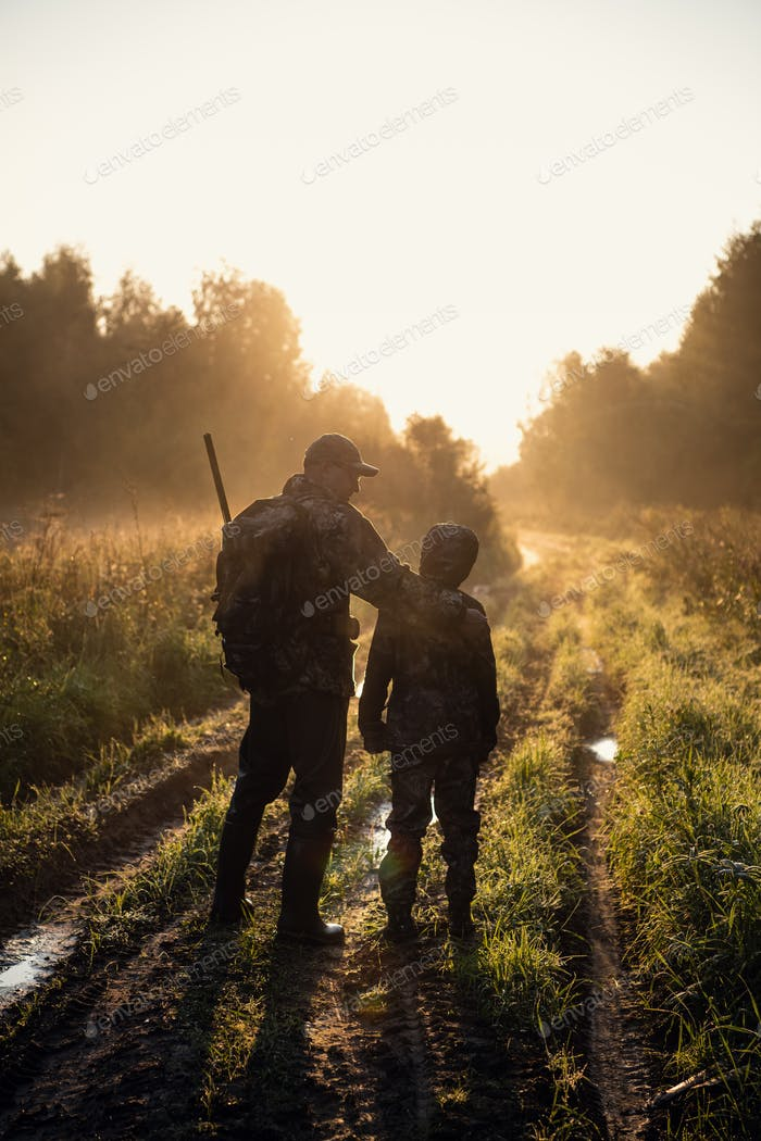 Thumbnail for father pointing and guiding son on first deer hunt