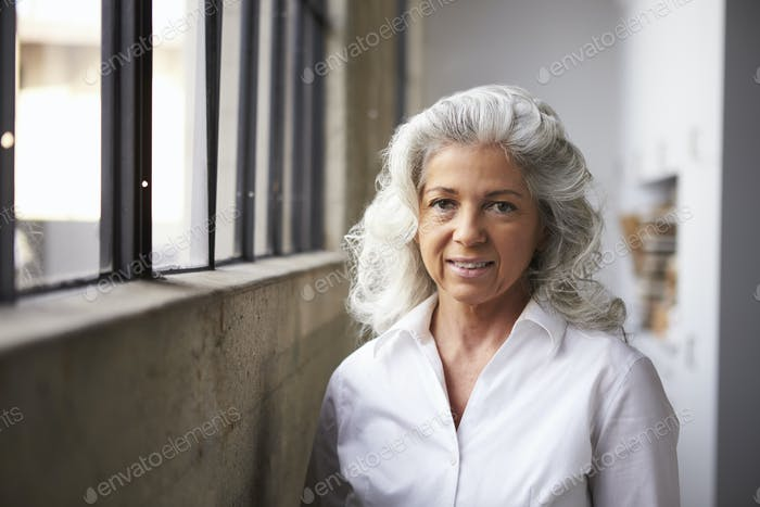 Senior white businesswoman in white shirt, portrait
