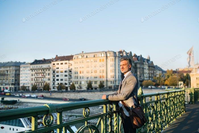 Mature businessman in a city.