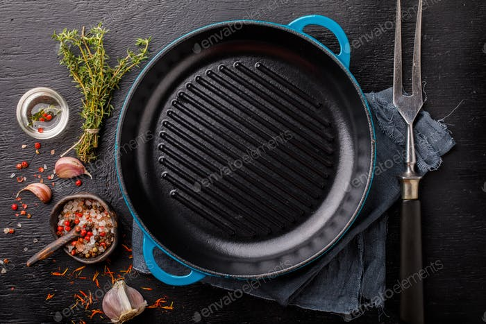 Frying Pan Cast Iron for grilling empty frying pan and meat fork