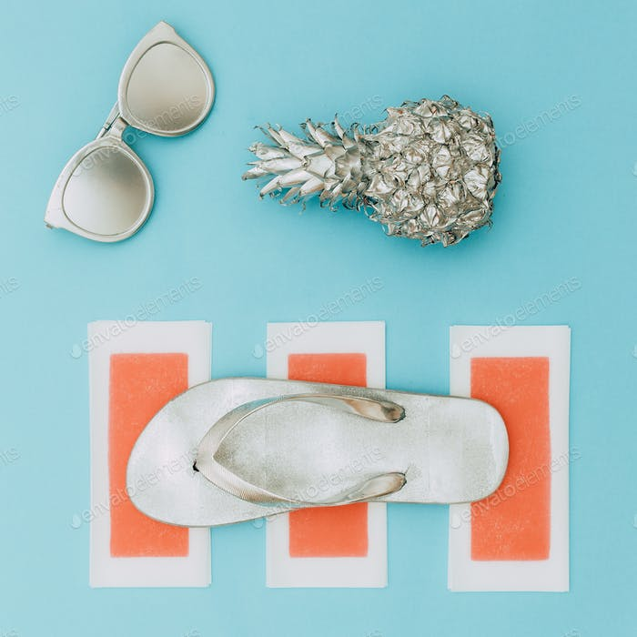 Minimal beach style. Silver set. Pineapple, sunglasses and flip-