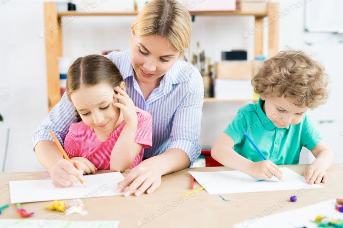 Children drawing with mother
