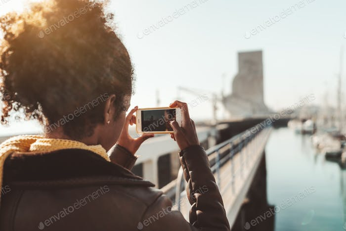 A girl photographing quayside area