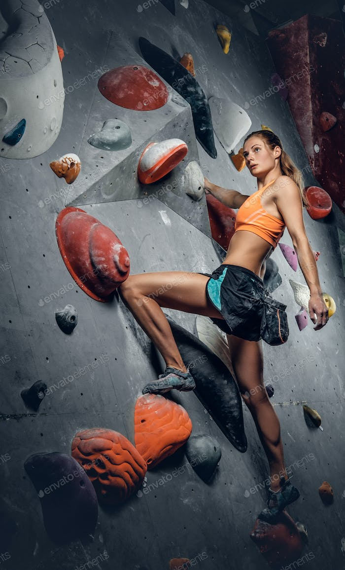 Female on indoor climbing wall.