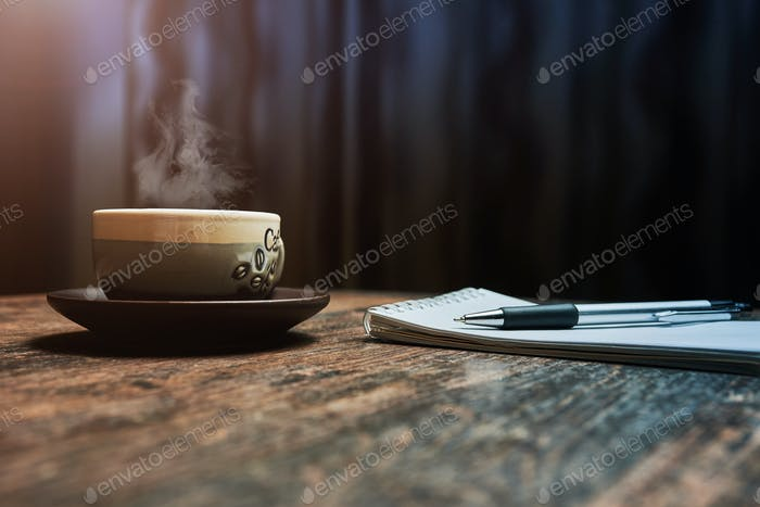 Workplace with a coffee Cup, on a wooden table