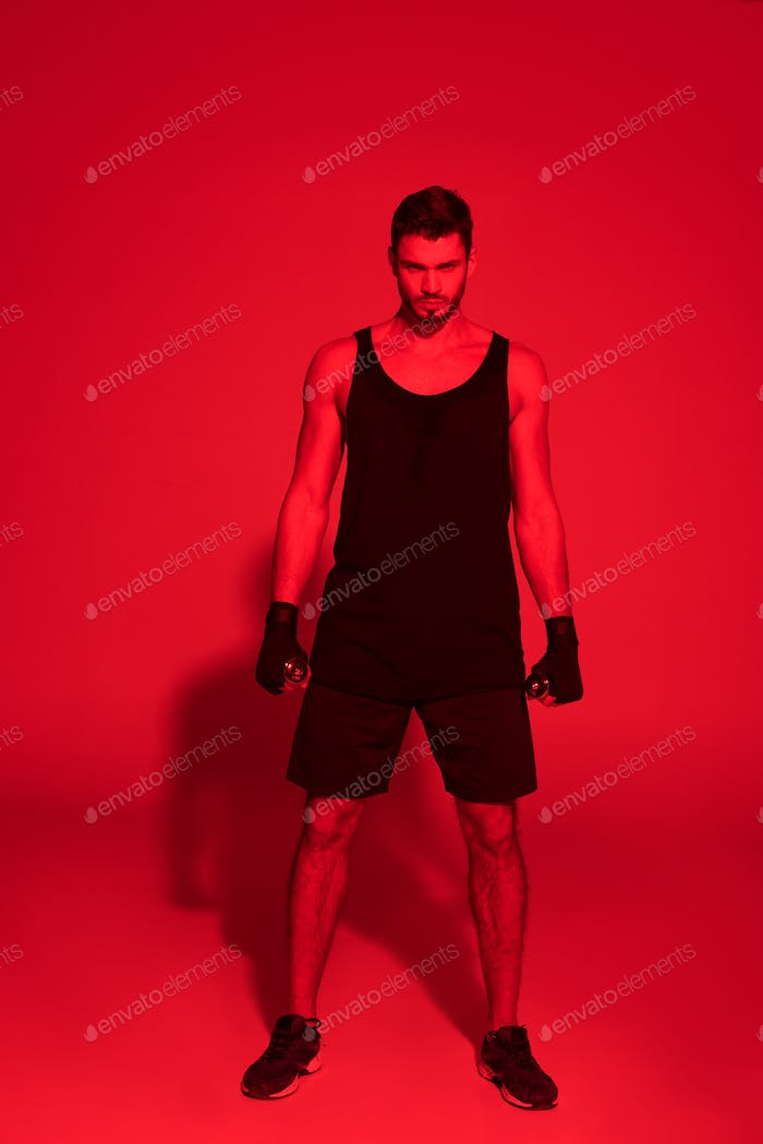 angry young fighter under red light