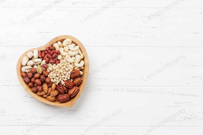 Various nuts selection on wooden table