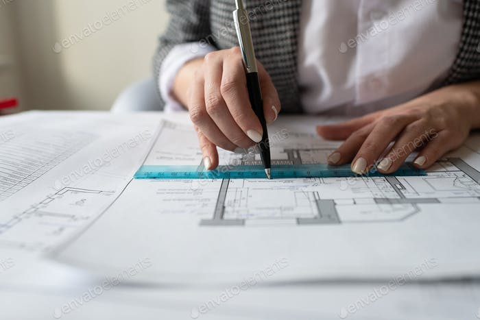 Cropped architect making draft in workplace