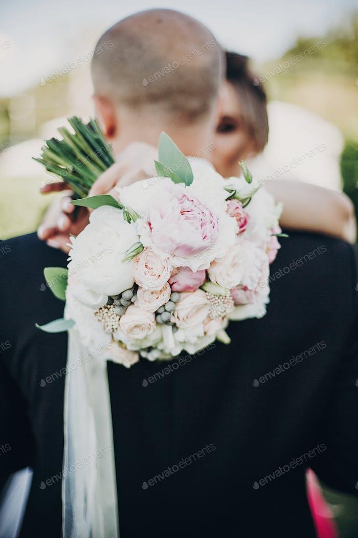 Modern wedding bouquet in bride hands