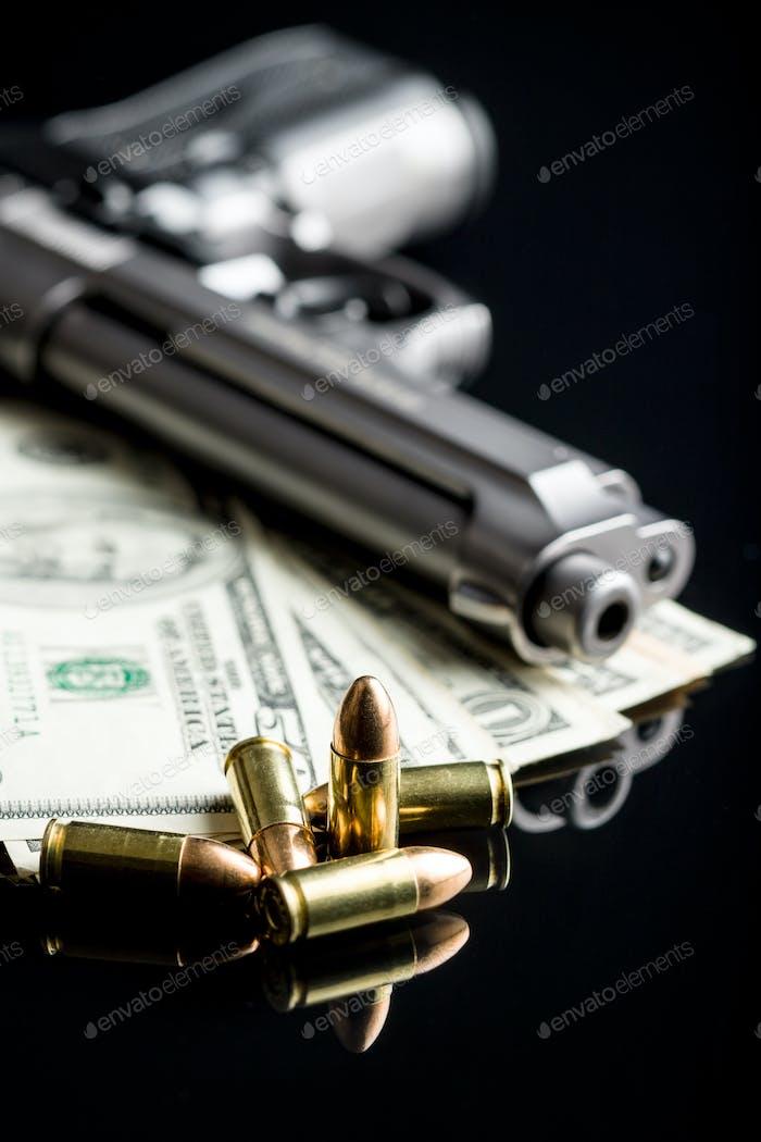 9 mm bullets, dollars and handgun.