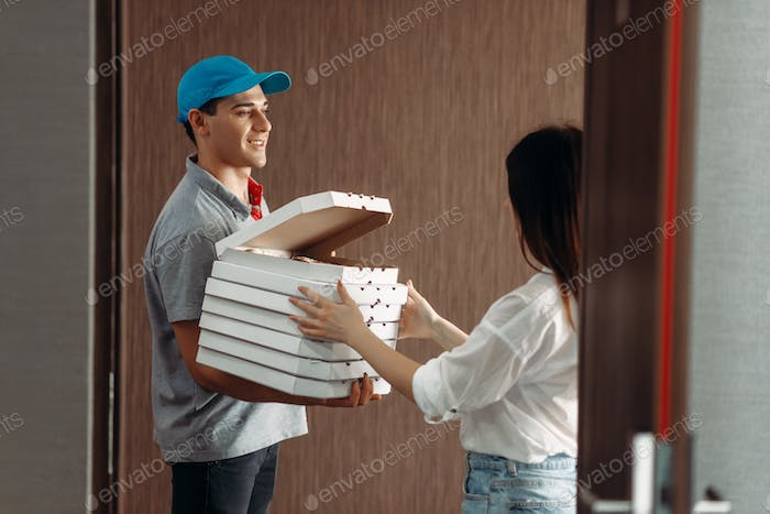 Delivery boy shows pizza to female customer