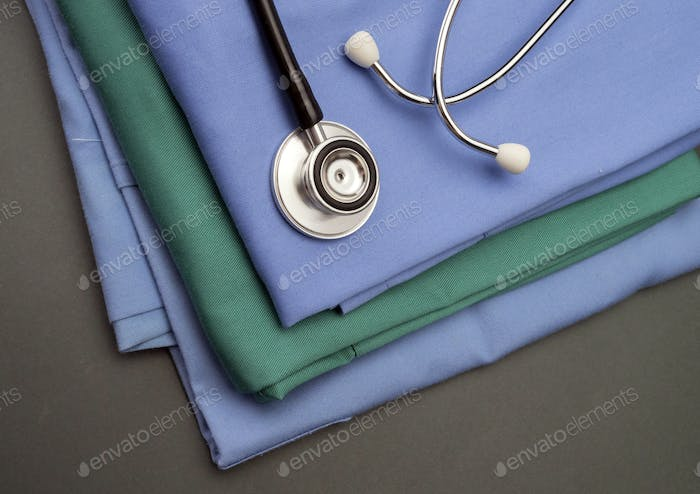 Stethoscope on clothes of nurse, conceptual image