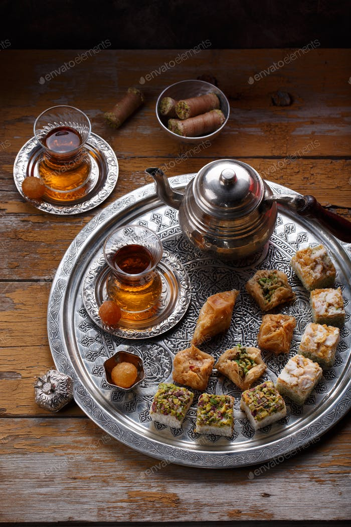 Traditional Turkish tea with oriental sweets, rustic copy space