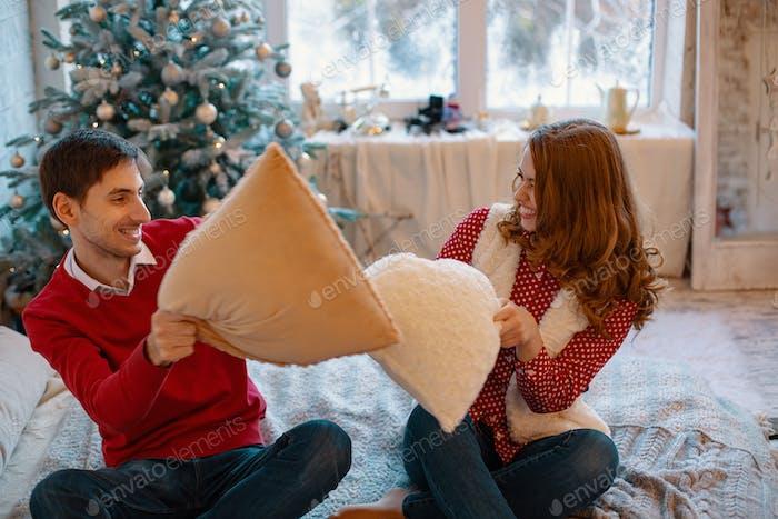 Enjoying couple pillow fight