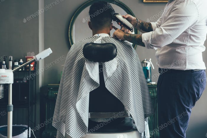 Getting trendy haircut at the barbershop
