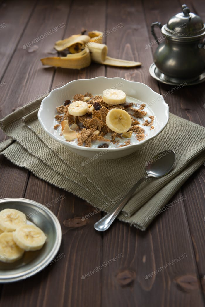 Breakfast cereals with milk and banana
