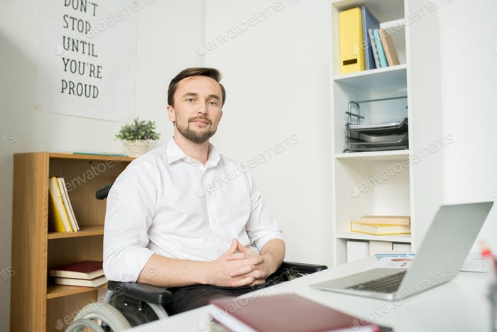 Confident disabled manager at office