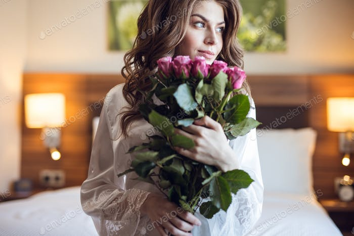 Beautiful youna girl with a bouquet of flowers