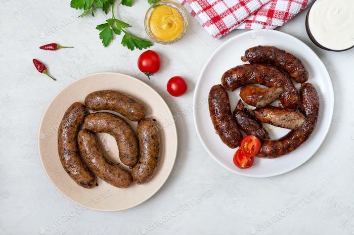 Juicy homemade pork sausage and vegetarian sausage with buckwheat