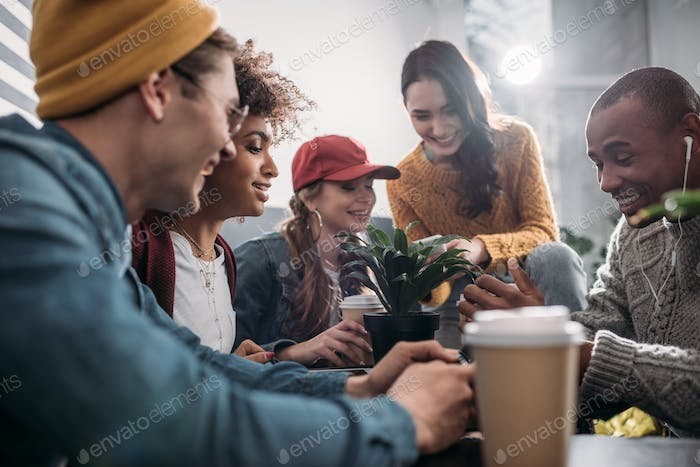 group of friends spending time together in cafe