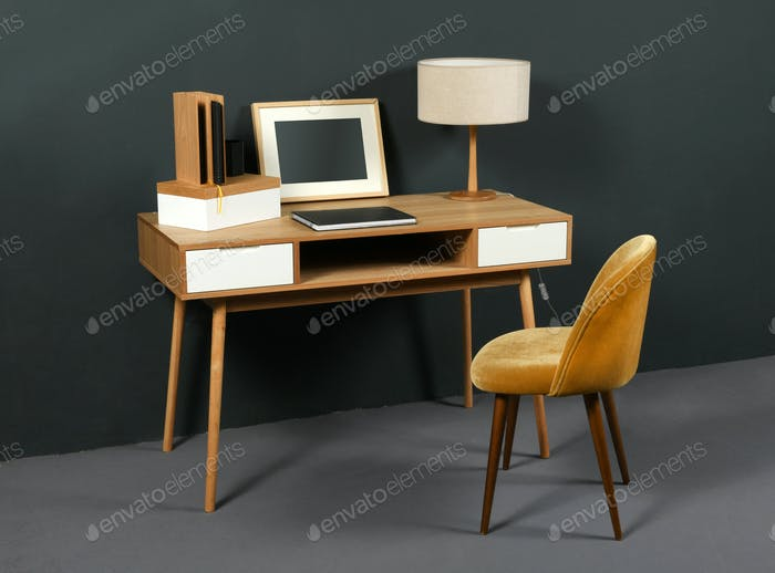 Old vintage desk with table lamp and chair