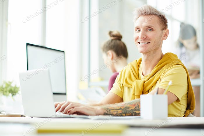 Tattooed Entrepreneur in Office