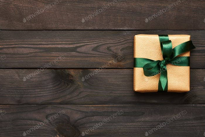 Christmas present on wooden background