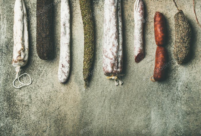 Variety of Spanish or Italian cured meat sausages, top view