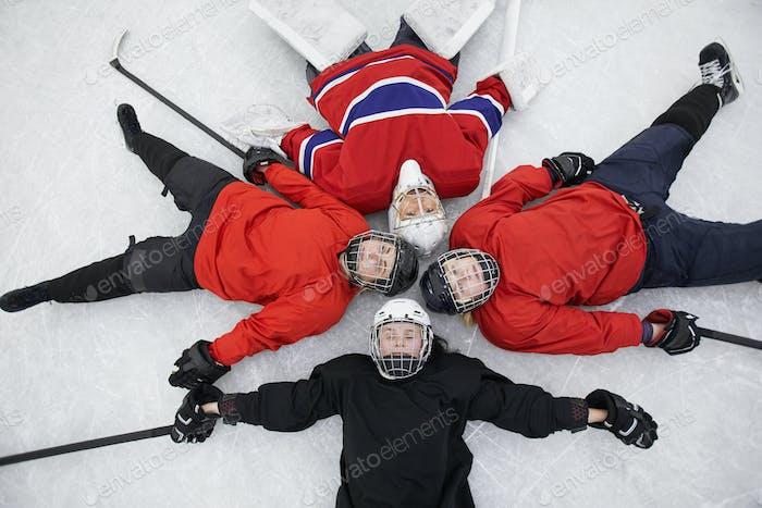 All Female Hockey Team Lying on Ice