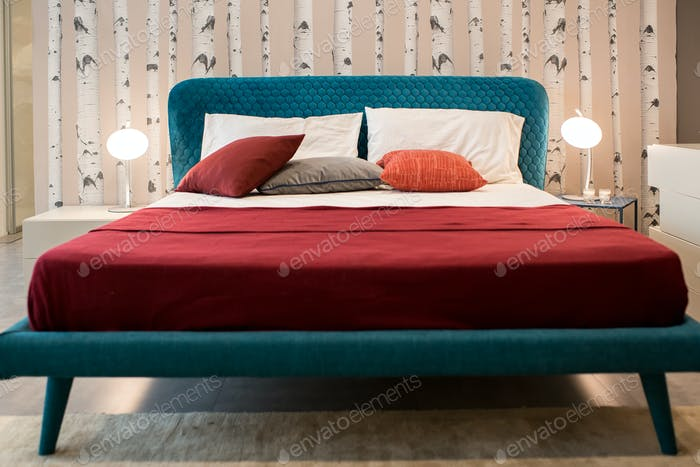 Vintage blue bed with red linens