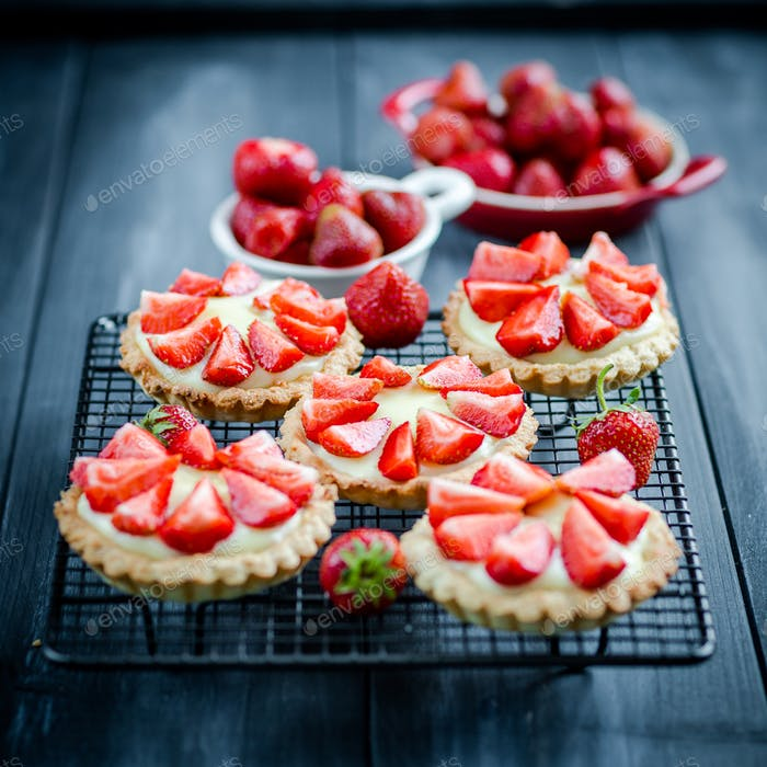 Homemade small delicious tartlets with strawberries