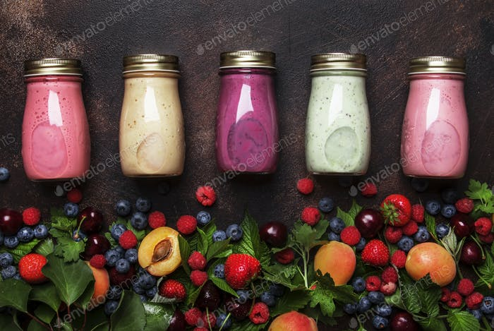 Colorful berry cocktail, smoothies and milkshakes
