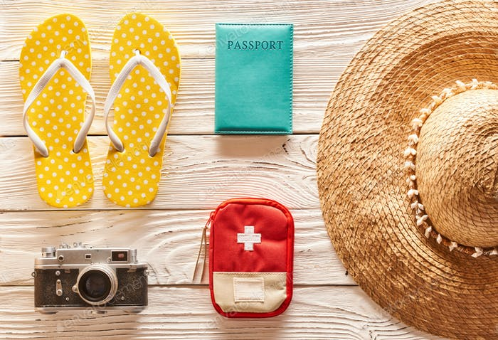 Travel and beach items flat lay