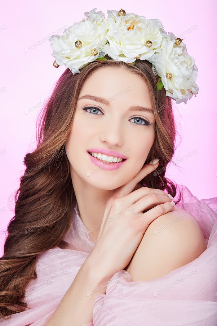 beautiful happy girl with pink makeup and flowers