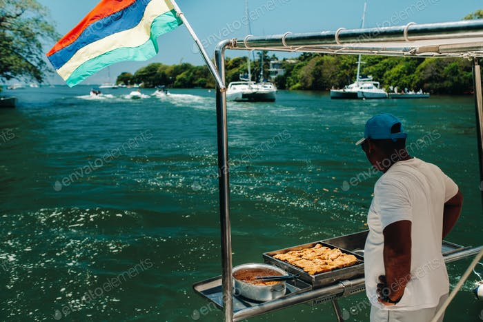 Barbecue on a boat in the Indian ocean near the island of Mauritius.The Mauritius flag
