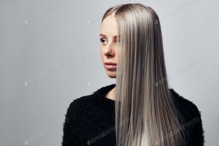 Portrait of a beautiful blonde woman with hairy jacket