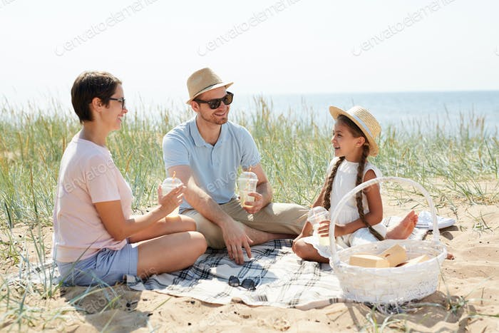 Family Enjoying Picnic on Beach