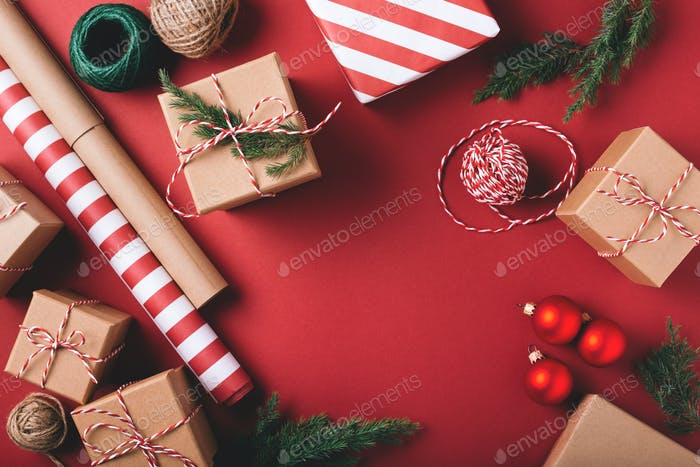 Christmas Gift Boxes and Decorations on Red Background.