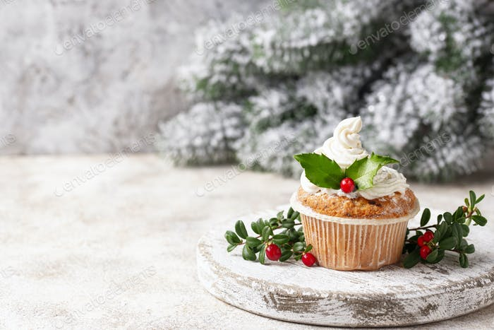 Christmas festive cupcake with holly leaves